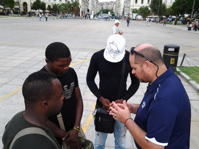 Bro. Tim praying with the three young men