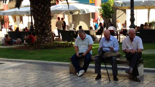 Three men in the square who asked us for tracts