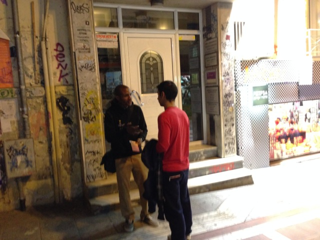 Kayode witnessing to a young man for a while