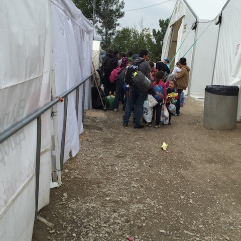 Part of a group of Syrian refugees leaving the camp for the nearby border