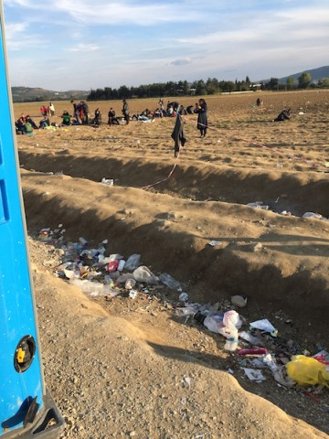 A view of the field that many of the refugees wait in & where we talk to some of them